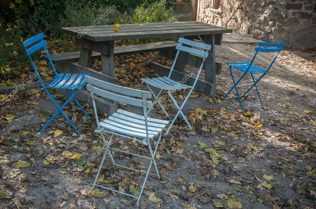 blues chairs in terrace garden by autumn