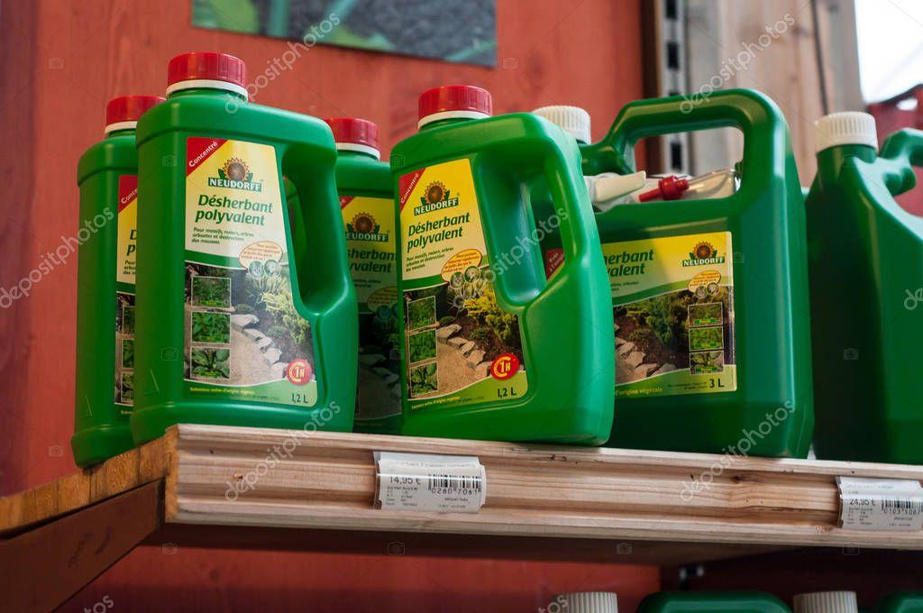 closeup of natural herbicide in rack in gardening supermarket