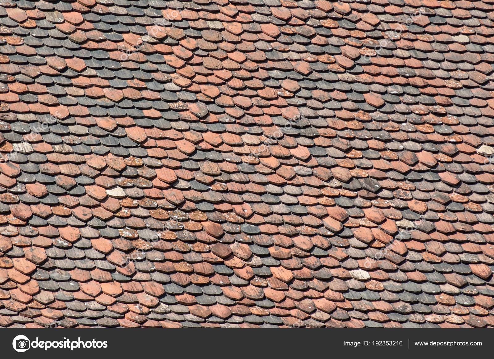 Terra cotta roof tiles texture — Stock Photo © NeydtStock #192353216