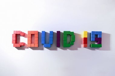 topic COVID-19 text message from wooden block toy of kid on white background
