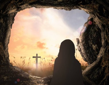 Resurrection Sunday of Jesus Christ concept: Tomb empty with cross at sunrise background