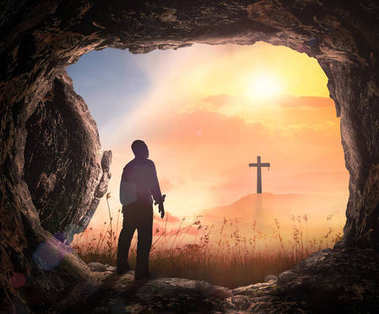 Resurrection of Jesus Christ concept: Tomb stone empty with cross at sunrise background