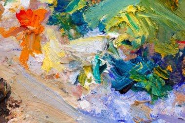 Multi coloured artists oil paint palette close up