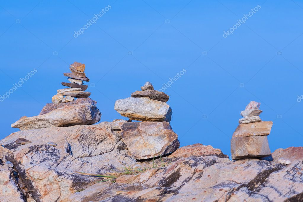 Rock stack over stone with clear blue sky background
