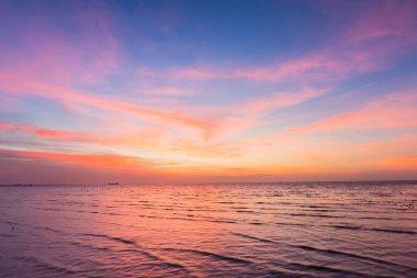Beautiful sky after sunset over seacoast skyline