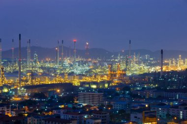 Petrochemical refinery with mountain background