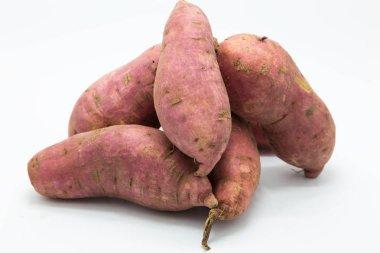 Purple fresh sweet potato on white