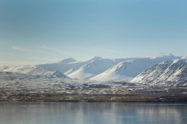 Iceland snow covered mountain during winter season