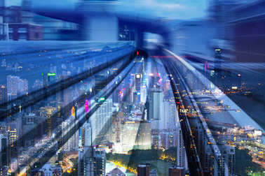 Twilight city Hong Kong downtown double exposure train track motion
