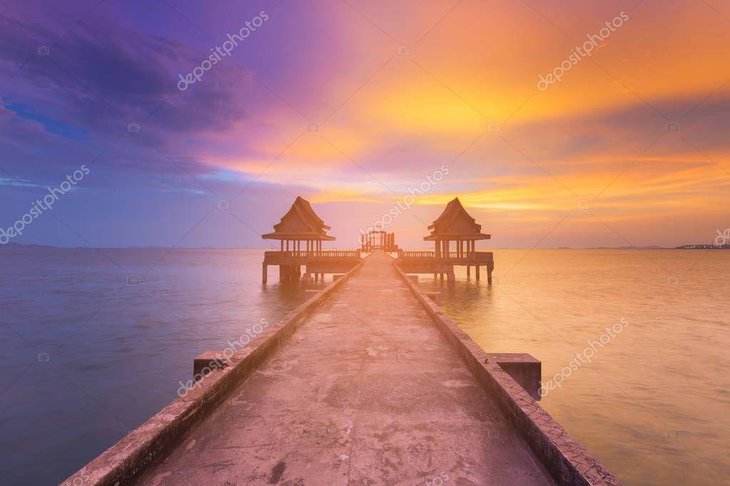 Beauty of sunset seacoast skyline with walkway to abandon temple