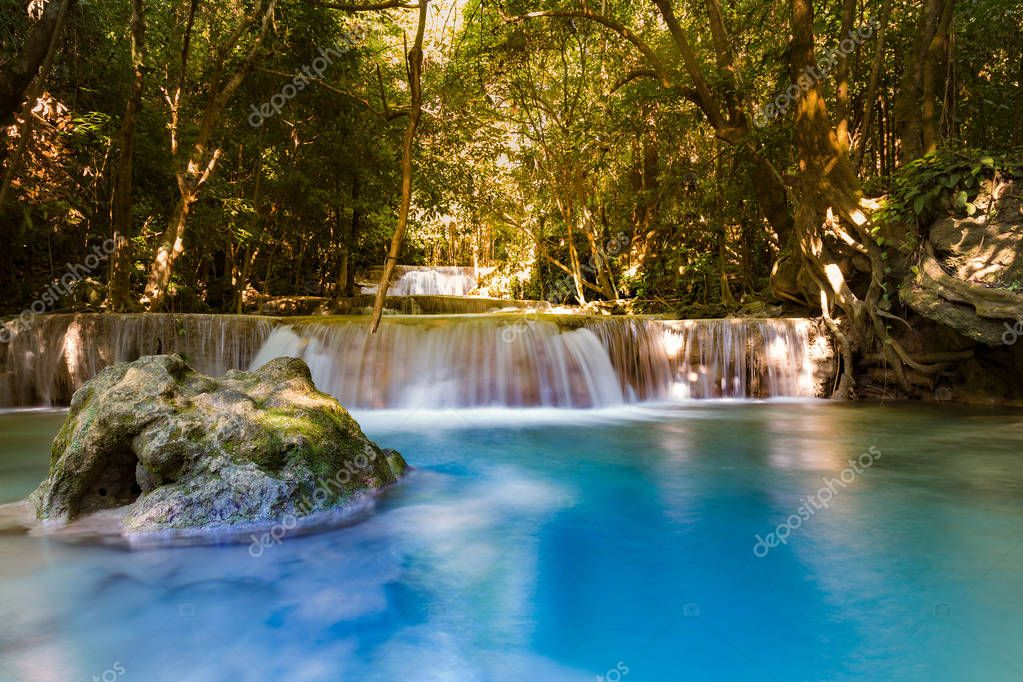 Фотообои Blue stream waterfall in deep forest jungle, natural landscape background