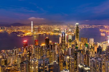 Twilight night view Hong Kong business downtown over Victoria Bay view from the peak