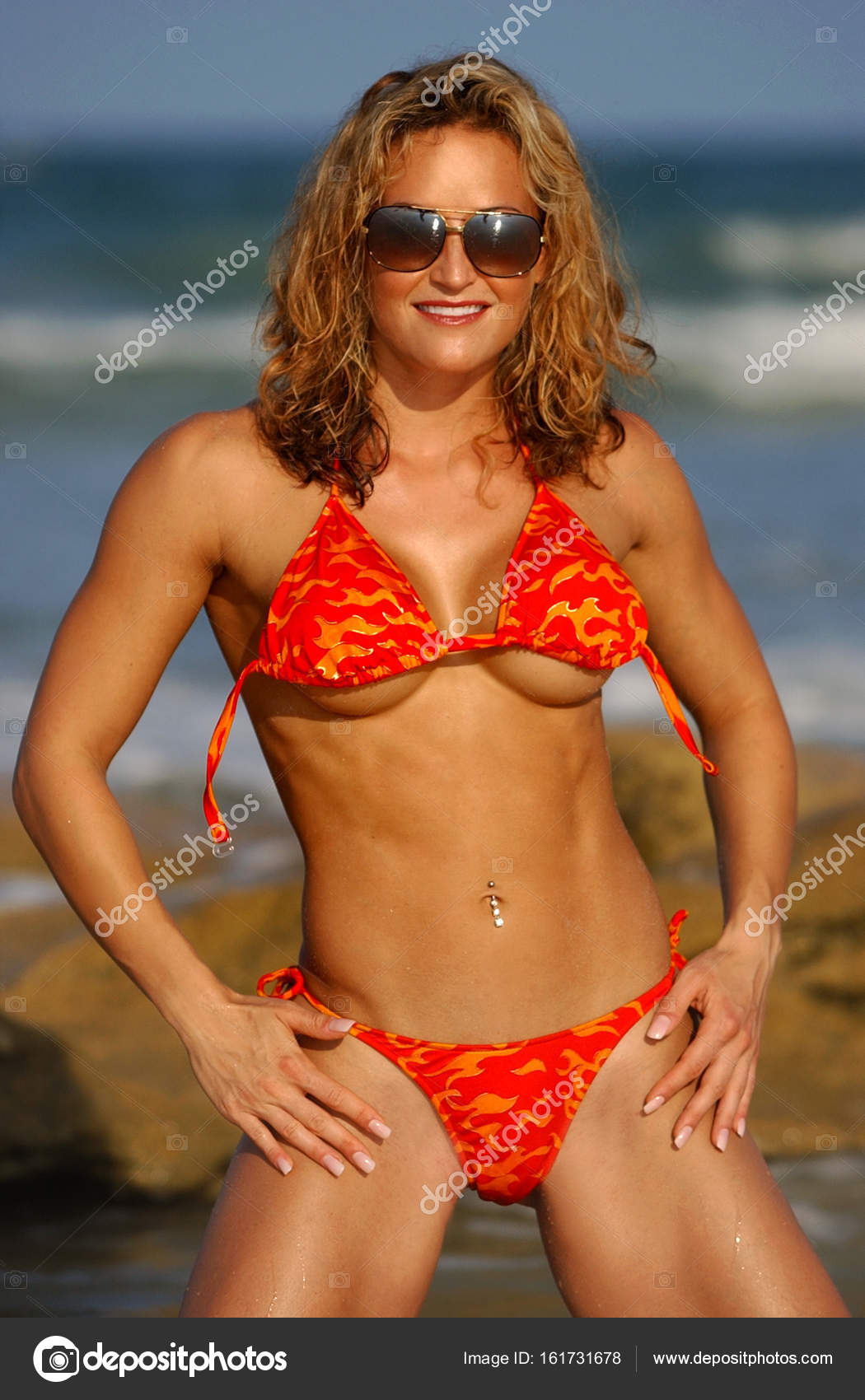 cute untied sting bikini on athletic beach babe — stock photo
