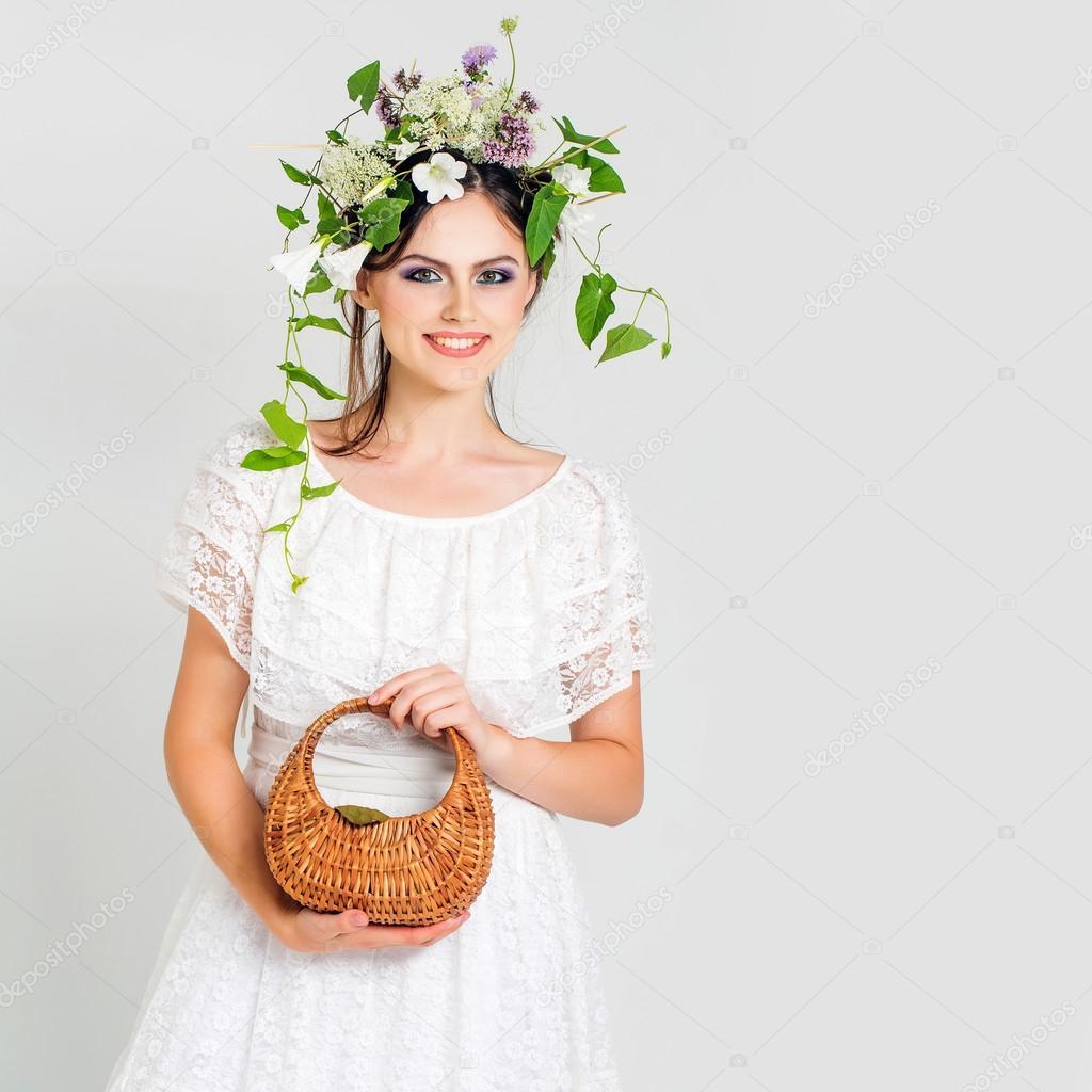 Young pretty girl with flower wreath stock photo tverdohlib young pretty girl with flower wreath stock photo izmirmasajfo