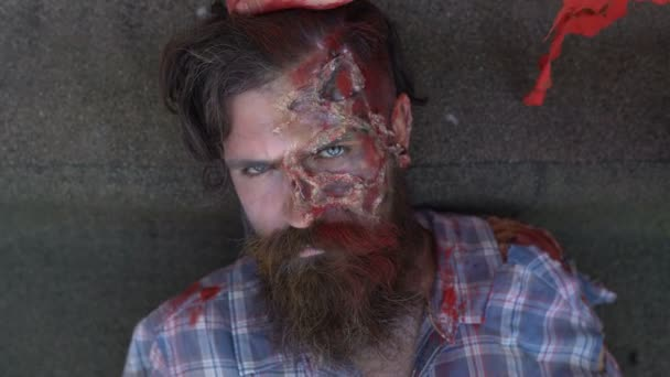 gently zombies, female hand in the blood touches the hair of a bearded man with a make-up in the style of Halloween
