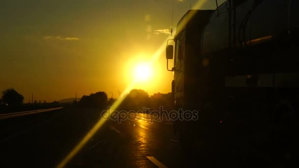 Slow motion: Truck on a highway at sunset. Reliable international transport, delivery of cargo