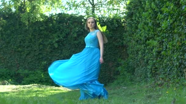 Slow motion: Sexy young beauty woman in fluttering blue dress