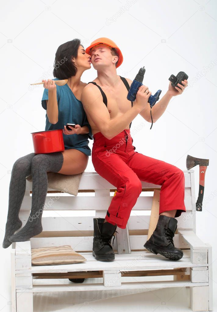 household muscular man and woman with cell phone
