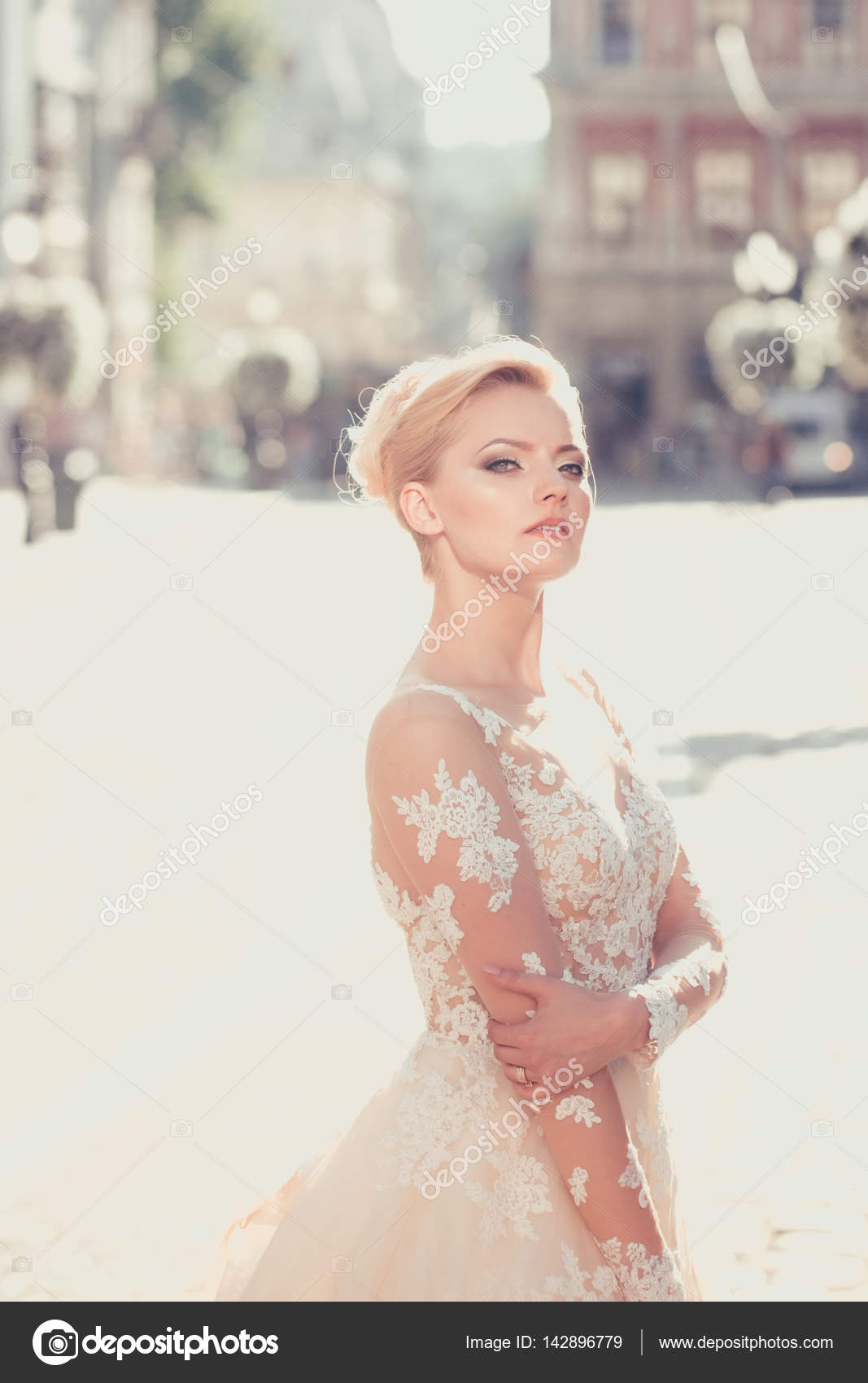 Pretty cute bride with beautiful makeup in wedding dress — Stock ...