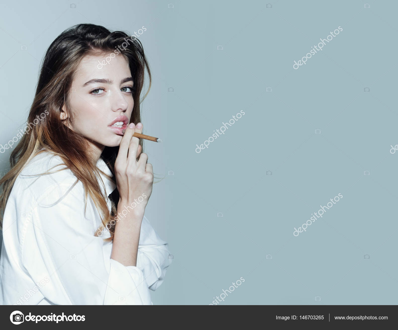 Young blonde teen smoking cigarette