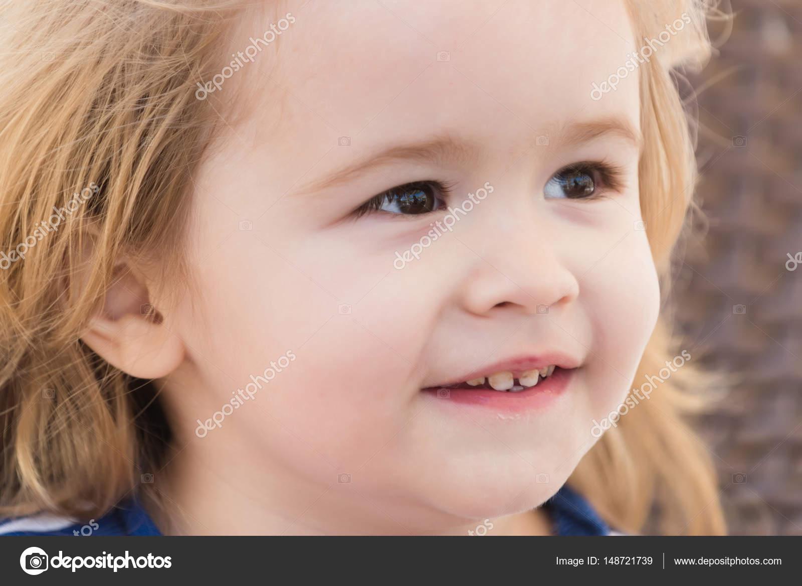 happy cute baby boy smiling outdoors — stock photo © tverdohlib