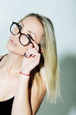 Pretty fashionable girl model in cute eyeglasses with blonde hair