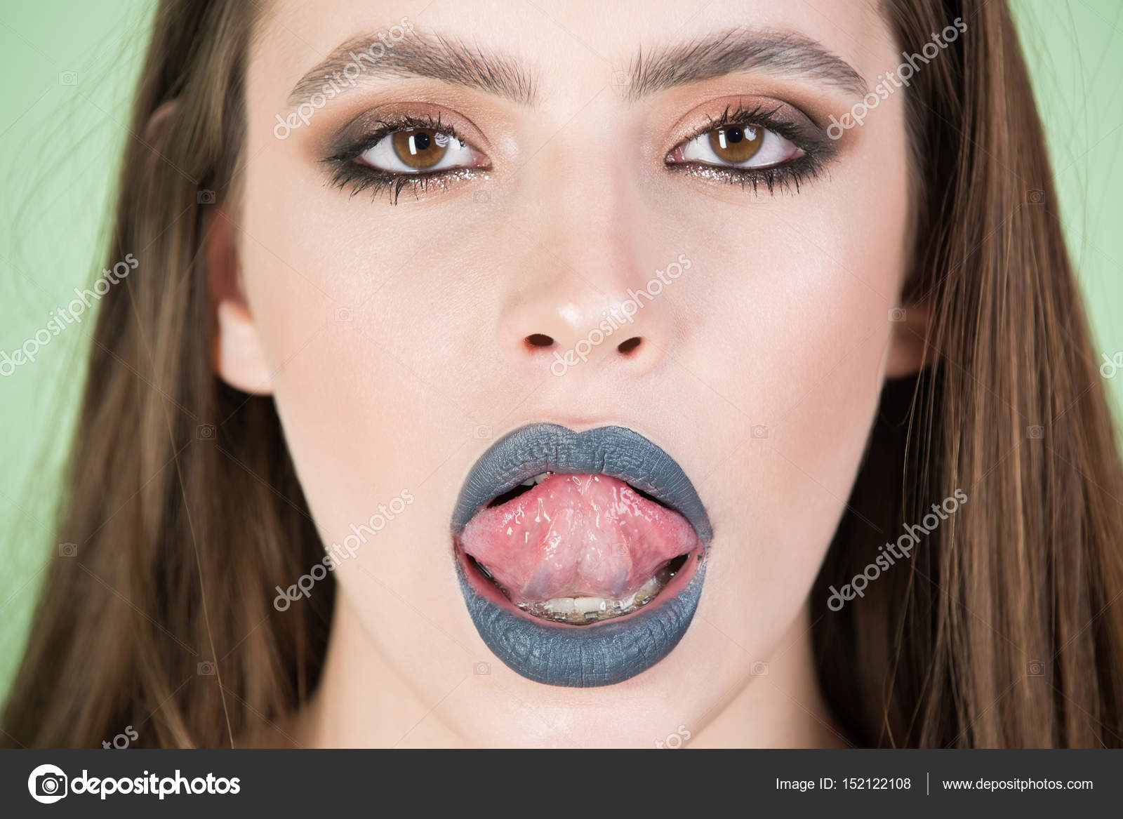 Fashion Beauty Girl With Grey Make Up Showing Tongue