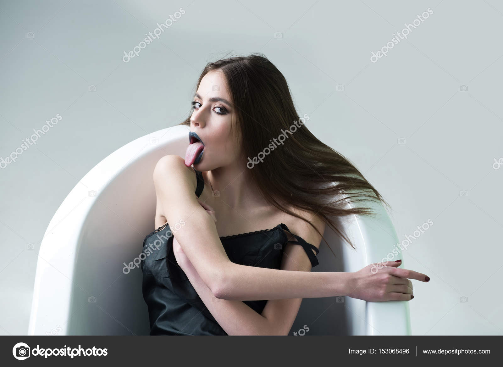 Sexi Girl In Bathroom. Y Woman In Dress With Black Lipstick In Bath Stock Photo