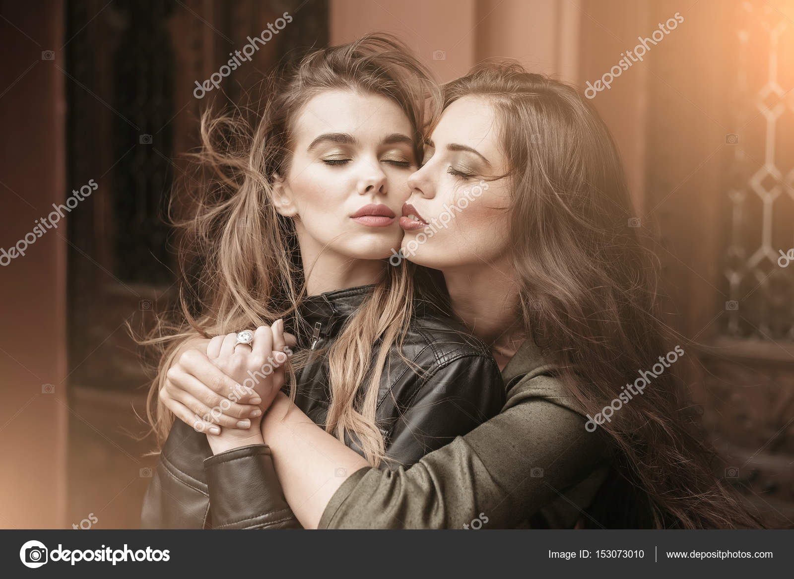 two pretty women with closed eyes hugging — stock photo © tverdohlib