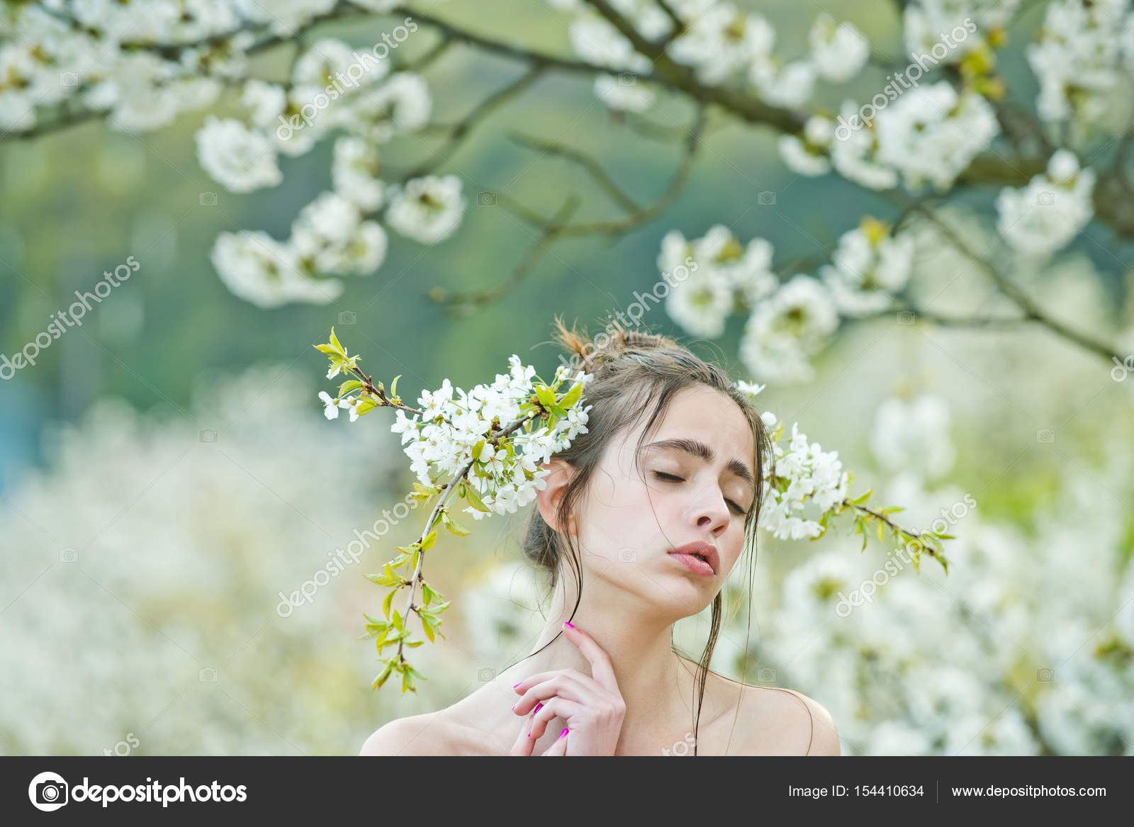 Cute girl with closed eyes and white flowers in hair stock photo cute girl or pretty woman with closed eyes on adorable face and white blossoming flowers in hair in spring garden on sunny day on blurred floral mightylinksfo