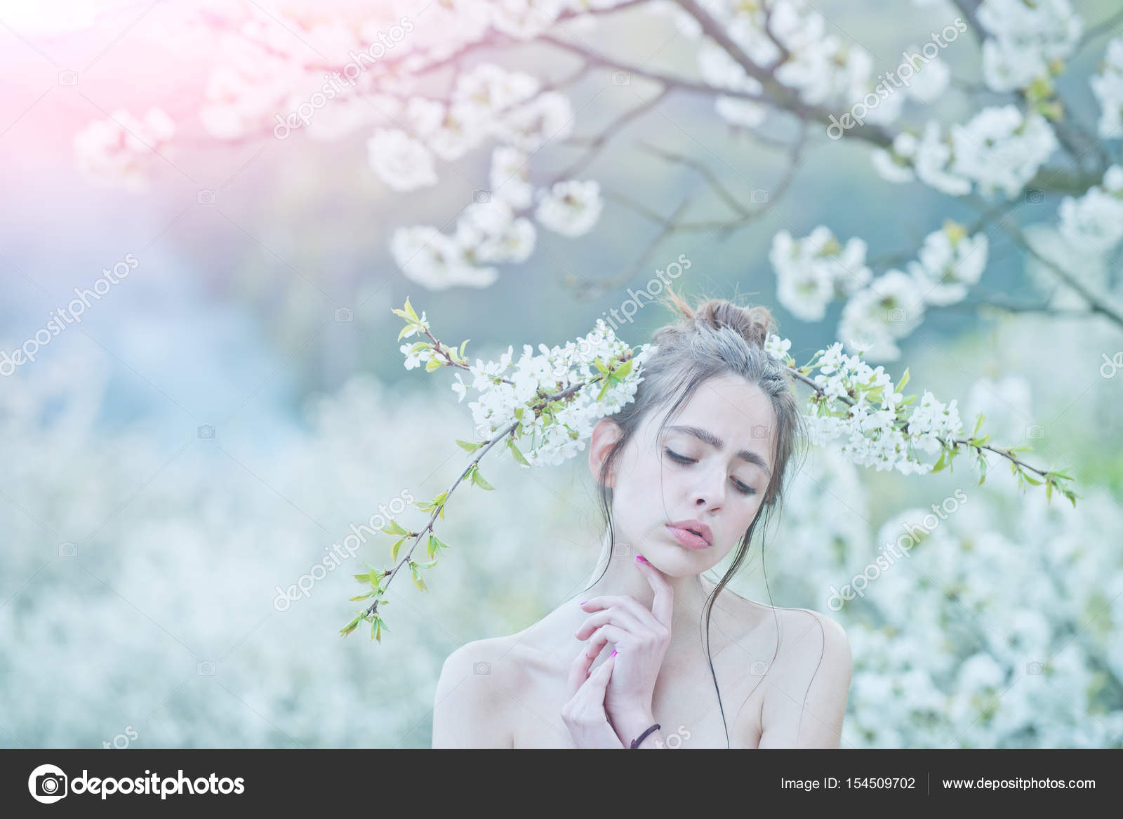 Girl With Closed Eyes And White Flowers In Hair Stock Photo