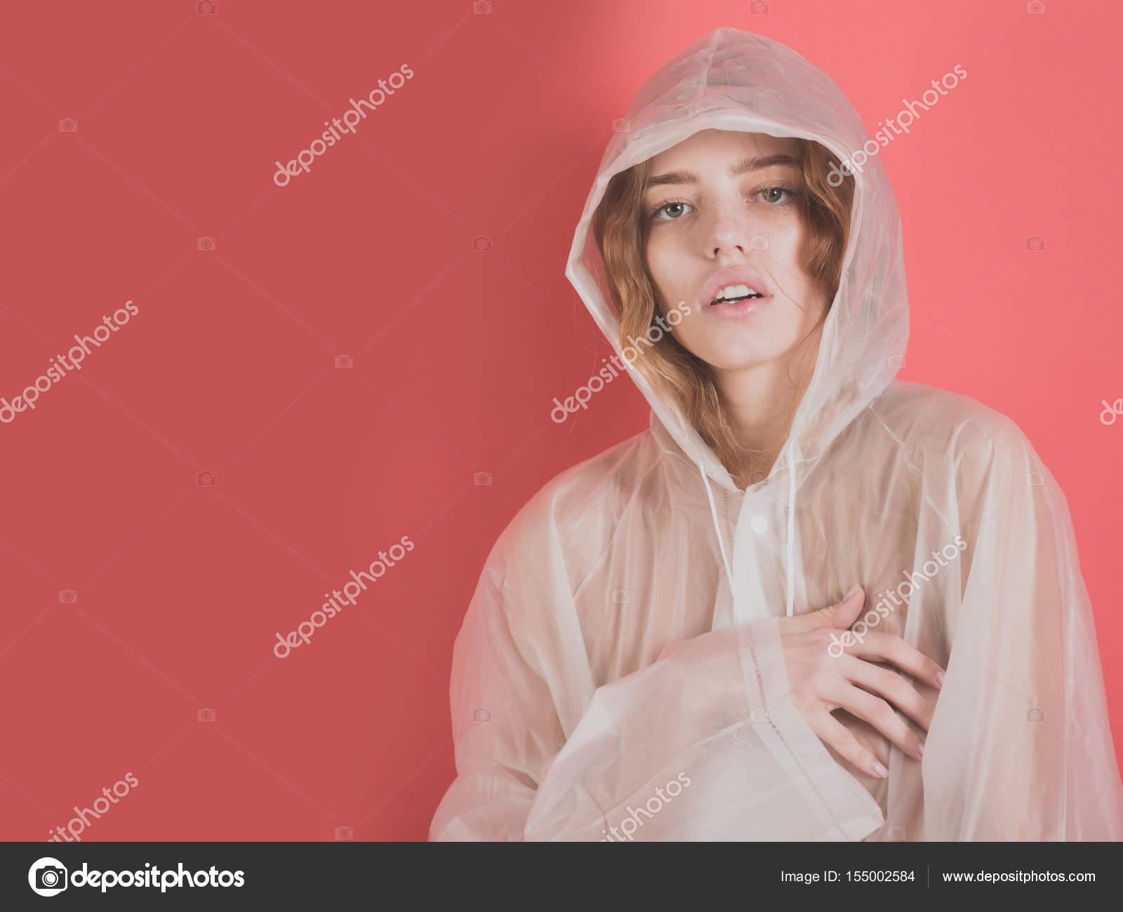 309af02f6 Pretty girl wearing plastic raincoat — Stock Photo © Tverdohlib.com ...