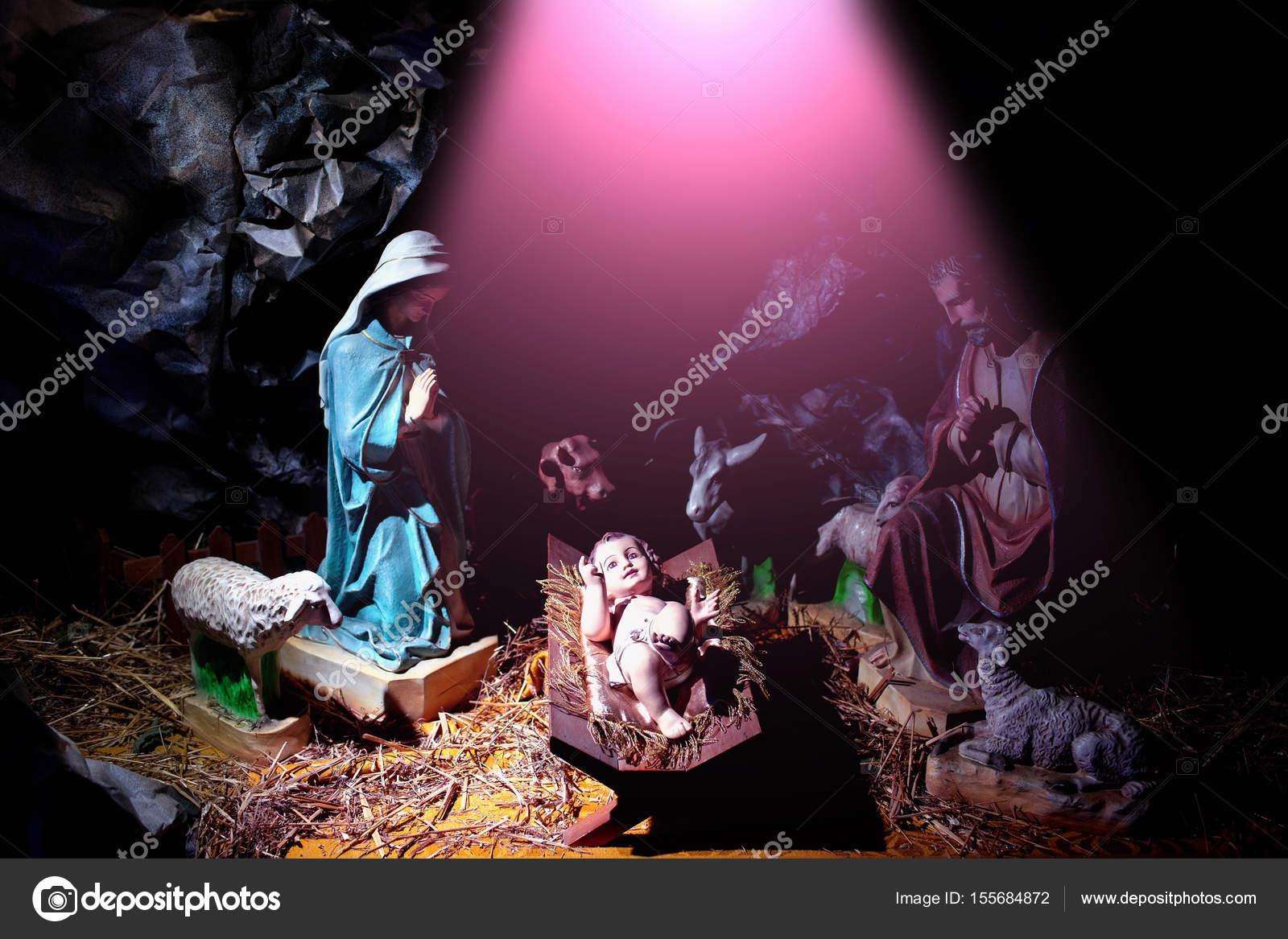 christmas infant jesus lying in manger in rays of divine light