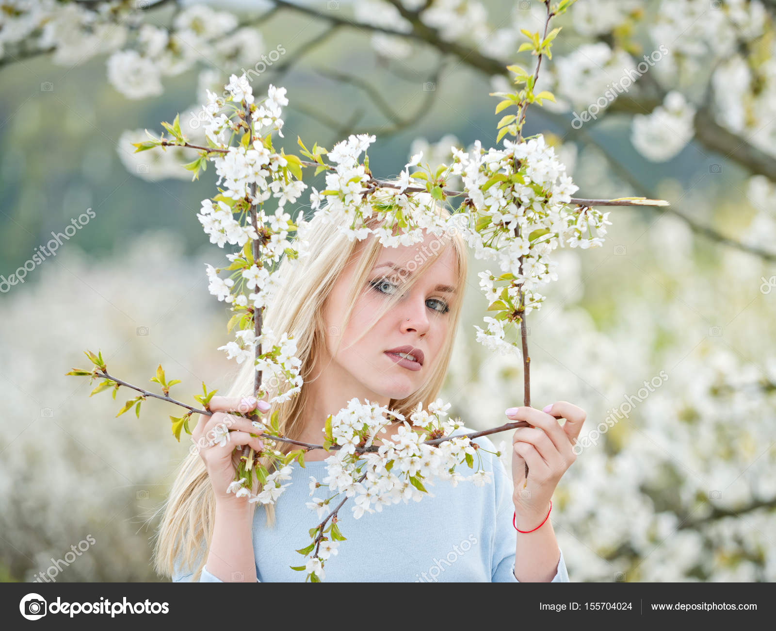 Young beauty and nature, girl, frame of white, blossoming flowers ...
