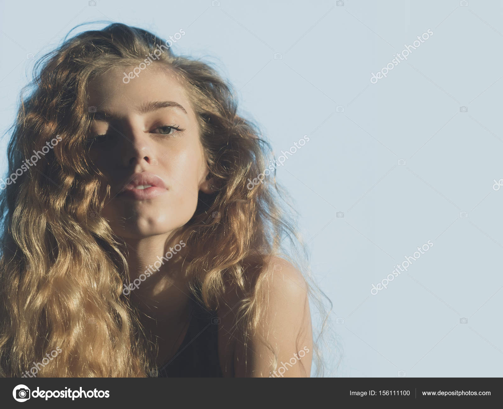 Cute Girlwith Young Face And Natural Blond Long Wavy Hair Stock