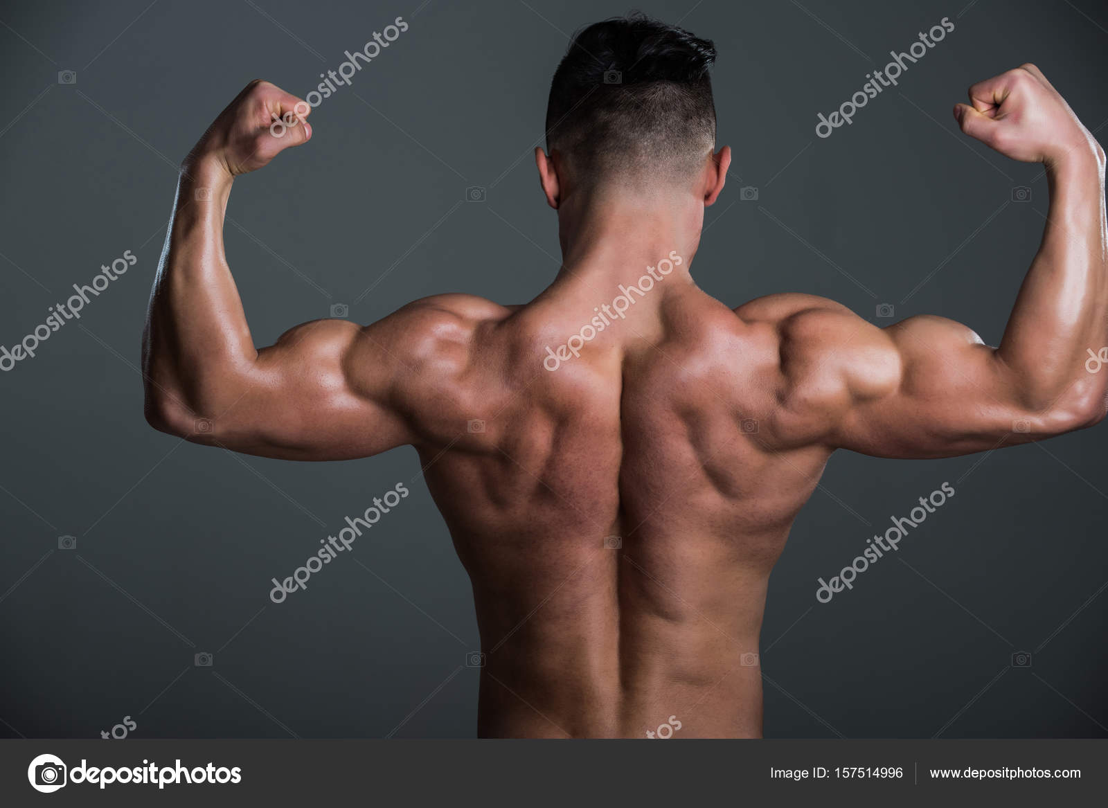 Muscular Man With Muscle Torso Showing Biceps And Triceps Stock
