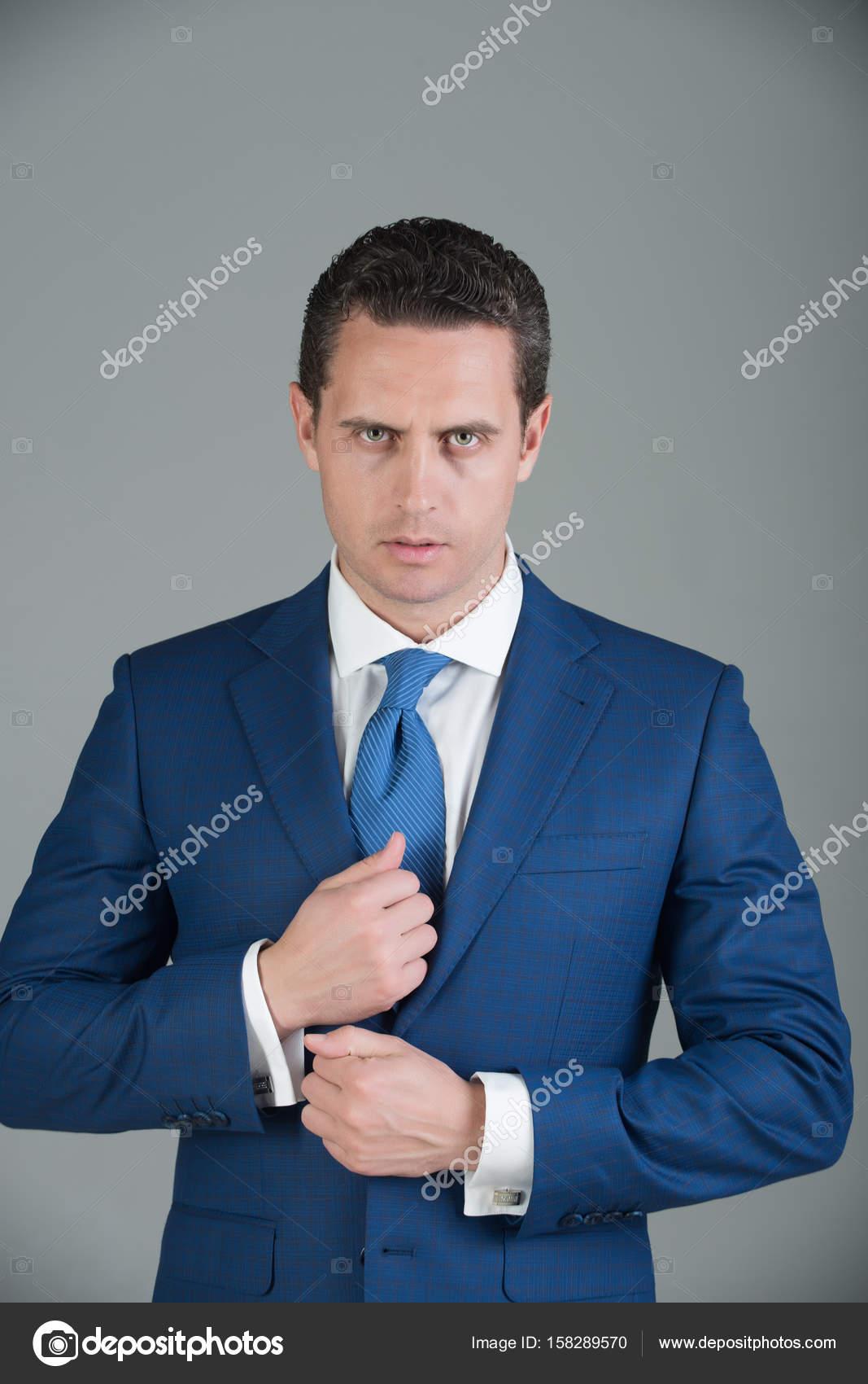 Confident Businessman Posing In Fashionable Blue Formal Suit Jacket
