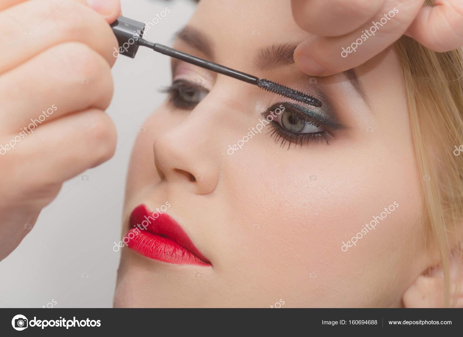 Fashion Model Girl Getting Mascara On Eyelashes Stock Photo