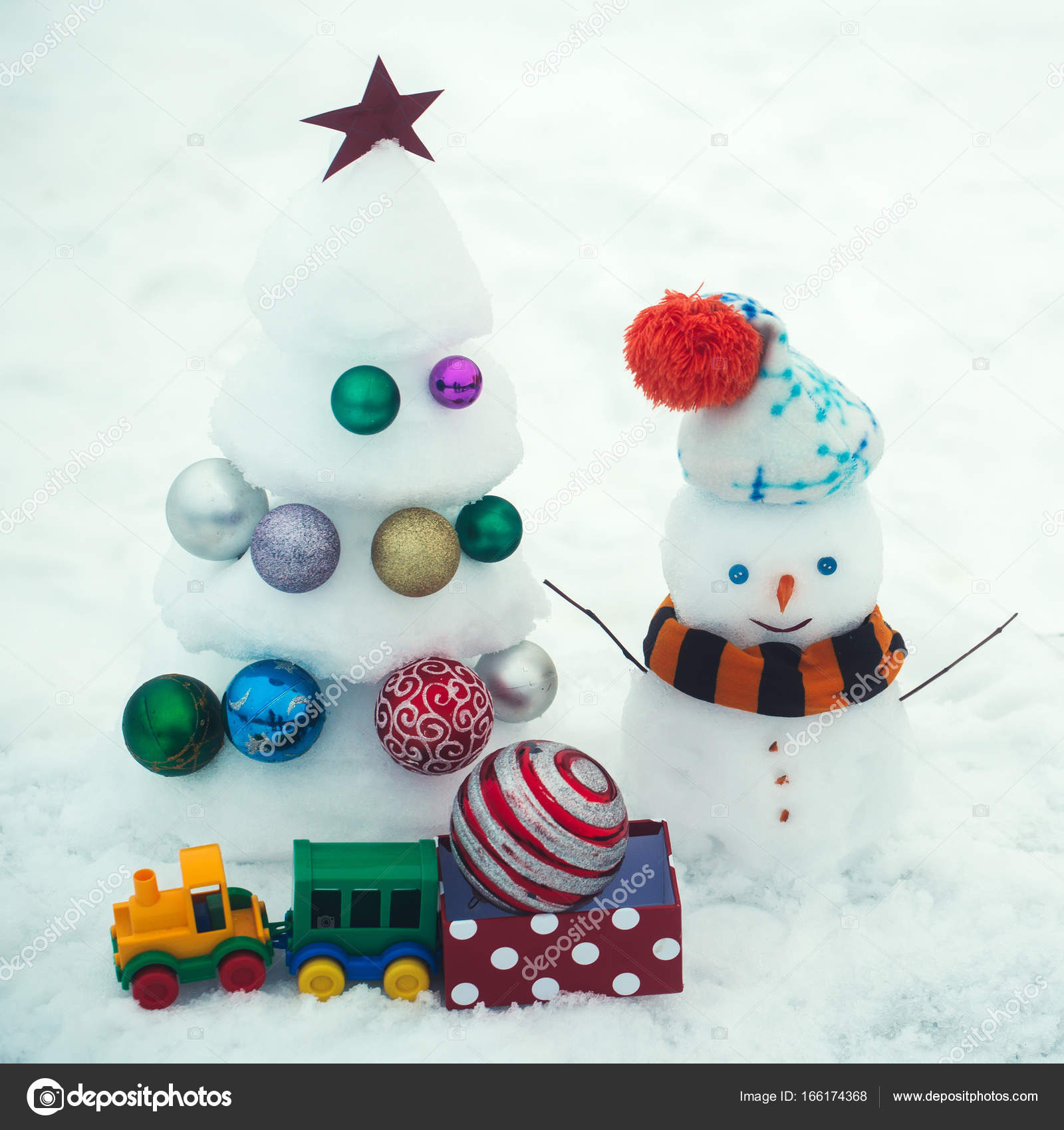 Christmas tree with decorations, toy train and present box — Stock ...
