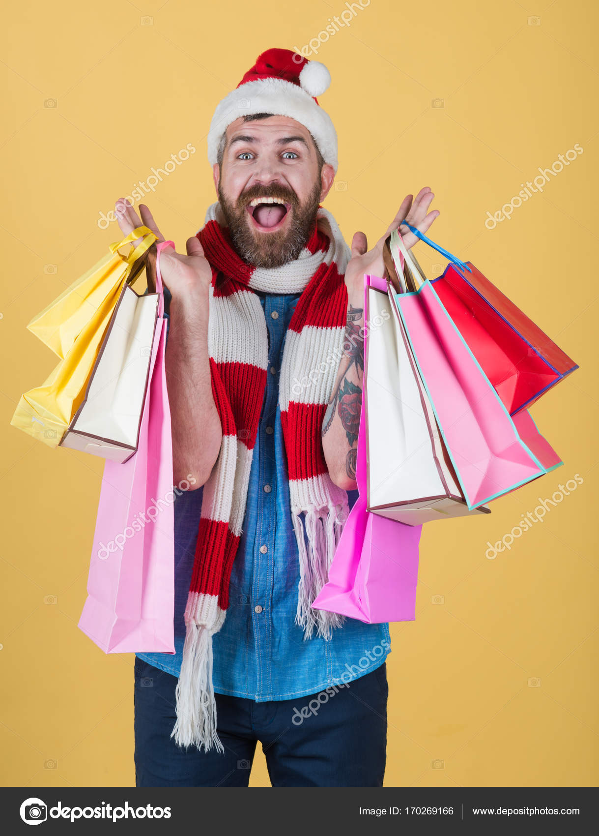 ebfc00915697b Christmas hipster shopper smile in santa hat and scarf — Stock Photo ...
