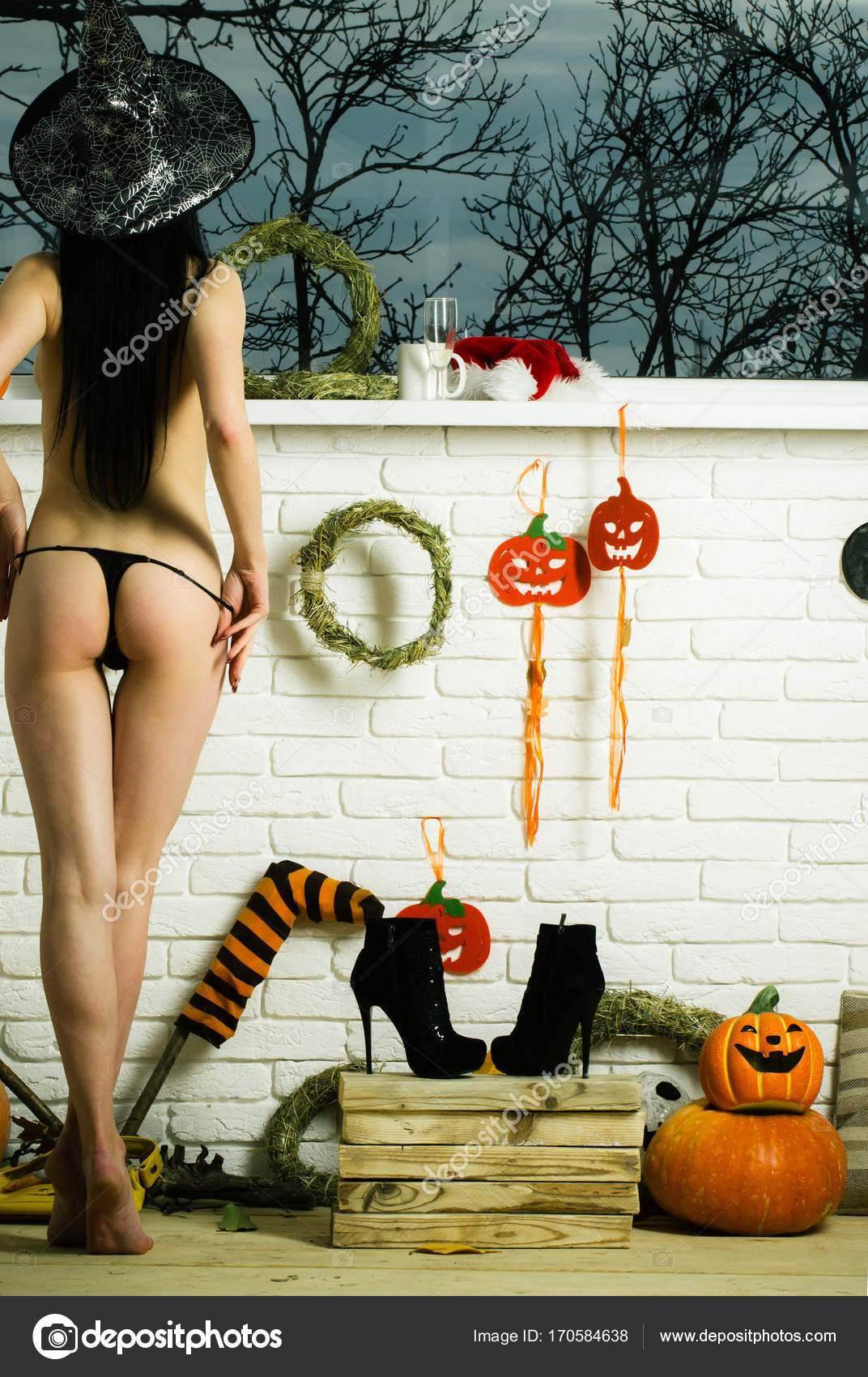 b828d6a2bbf Halloween girl in witch hat undressing black strings — Stock Photo ...