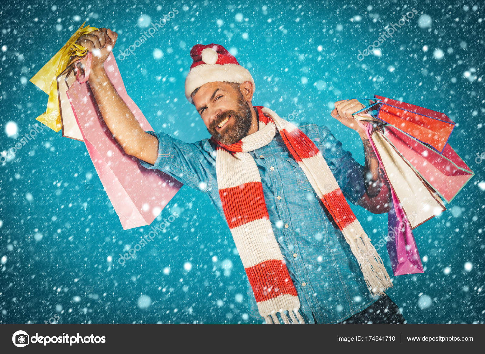 30624db7d4009 New year christmas snow concept Christmas man shopper happy smile in santa  hat and scarf. Black friday sale concept. New year