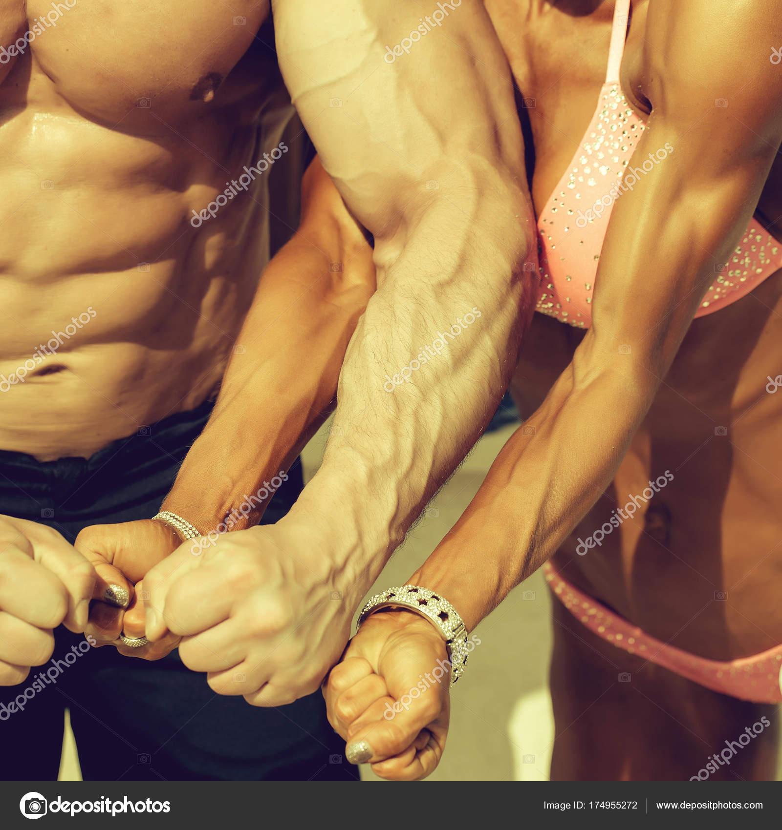 Sporty Couple Show Muscular Arms Stock Photo Tverdohlib
