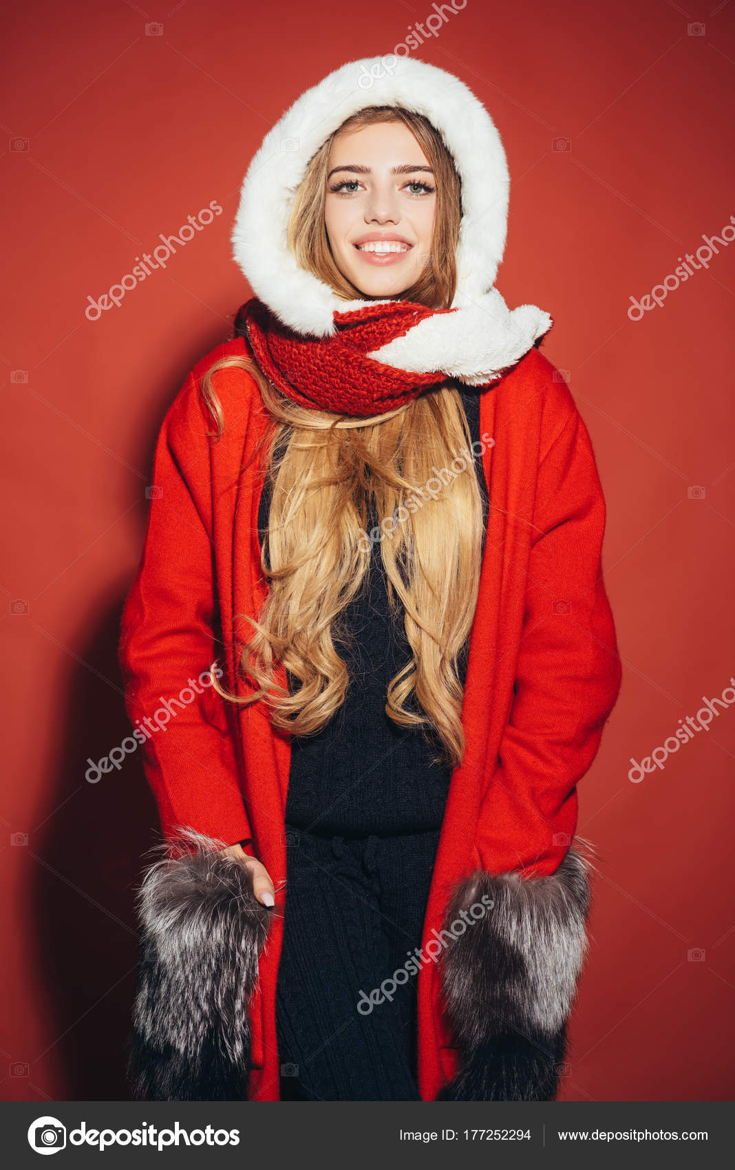 b807c9c7df Woman in santa costume with pretty face. Christmas woman in red hat. Xmas  party and winter holiday. Happy girl celebrate new year on red background.