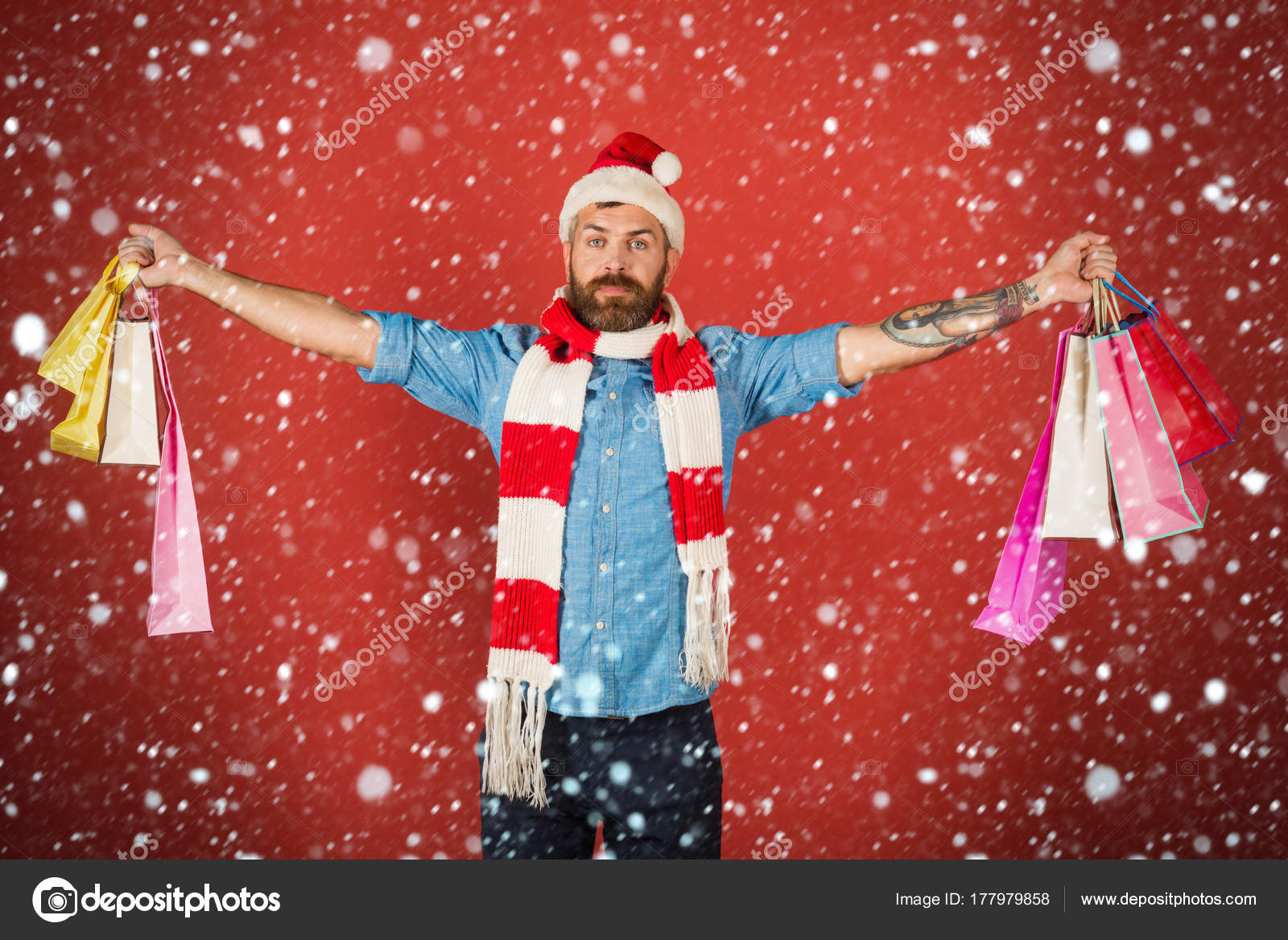 b3312a2768988 Christmas and new year snow concept Christmas hipster hold shopping bags on  red background. Man shopper wear santa hat and scarf. Black friday sale  concept.