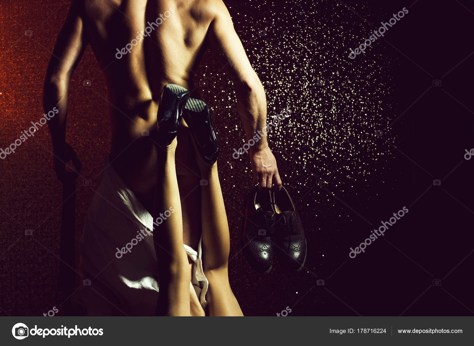 Muscl guy around sexy girls holding them Muscular Man With Sexy Woman Holding Fashionable Leather Shoes Stock Photo By C Tverdohlib Com 178716224