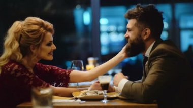 Beautiful couple in a restaurant. Romantic couple dating in pub at night. Couple have romantic evening in restaurant.