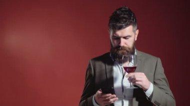 Bearded man tasting red wine. Drunk man