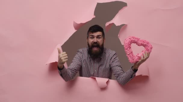Bearded man with pink heart. Valentines day concept.