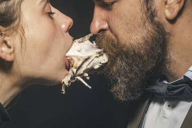 Couple enjoys meal, meat or fowl. Man and woman